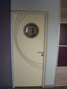 Fabrication et réalisation d'un porte intérieure avec motifs pour l'agencement intérieur sur Les Herbiers par Merlet Luc